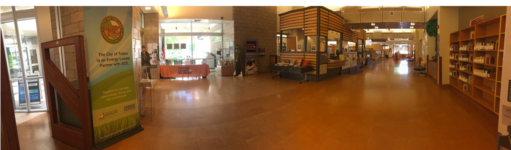 A panoramic view of the Tulare Public Library entrance, Veteran Resource Center, and Circulation Desk.